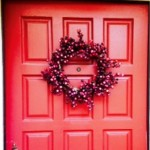 Red door with wreath